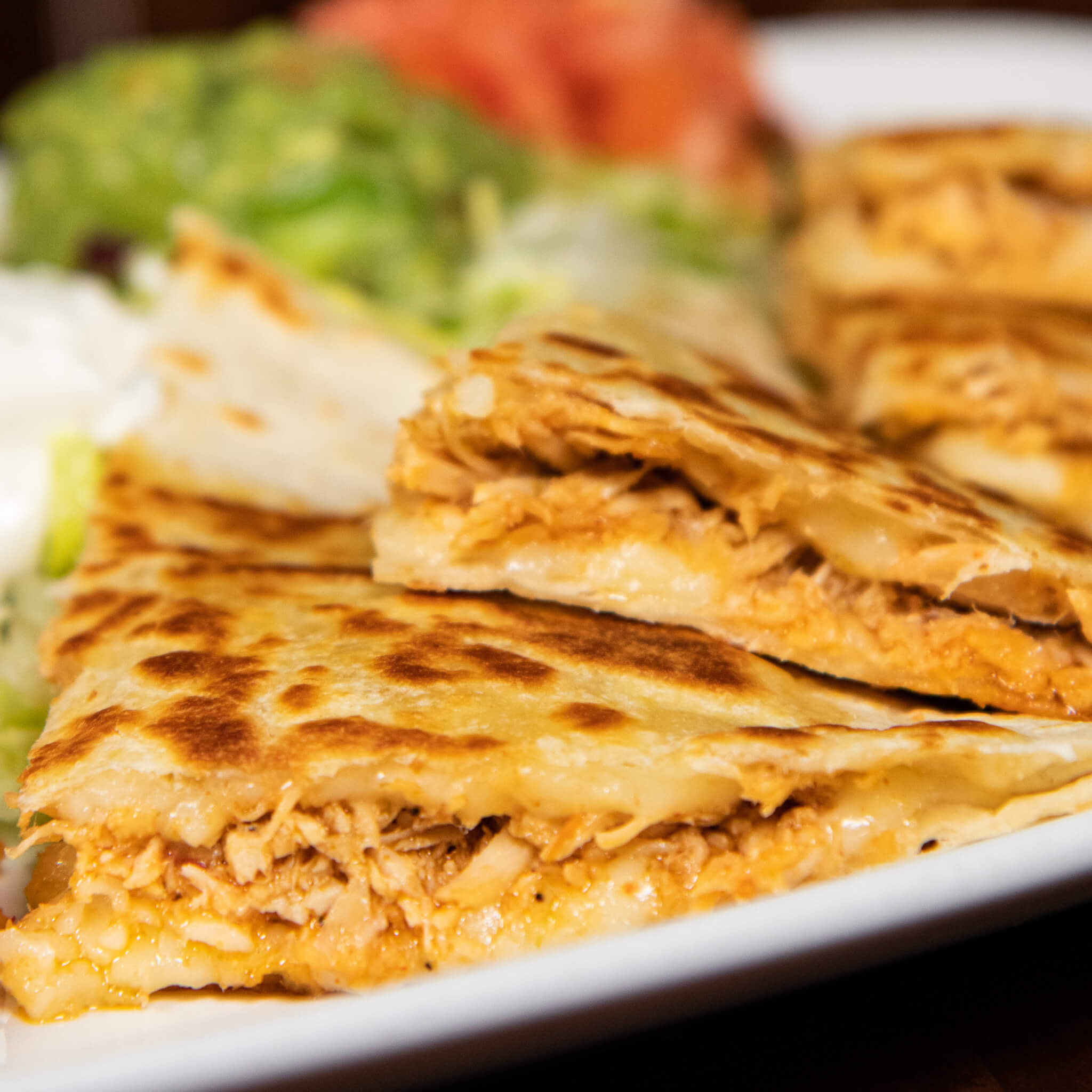 $1.99 Shredded Chicken or Ground Beef Quesadillas
